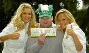 7 September 2005; Ireland fan Kevin Moore, Dungarvan, Co. Waterford, with models Joanne Dever, left, and Jenny O'Dwyer, was celebrating after winning tickets to the big match from www.carlsbergmoments.ie, a website created by Carlsberg for fans to vote for their favourite World Cup moment - Kevin voted for Kevin Sheedy's goal against England in Italia '90. Ray Houghton's goal against Italy in USA '94 is currently leading the poll. Berkeley Court Hotel, Dublin. Picture credit; Brendan Moran / SPORTSFILE