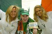 7 September 2005; Ireland fan Jim Kinsella, Enniscorthy, Co. Wexford with models Jenny O'Duffy, left, and Joanne Dever, was celebrating after winning tickets to the big match from www.carlsbergmoments.ie, a website created by Carlsberg for fans to vote for their favourite World Cup moment -  Jim voted for McAteers goal against the Dutch in the 2002 qualifiers. Ray Houghton's goal against Italy in USA '94 is currently leading the poll. Berkeley Court Hotel, Dublin. Picture credit; Brendan Moran / SPORTSFILE