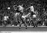 21 September 1986; Eoin Liston, Kerry, in action against Ciaran McGarvey and Harry McClure, (9), Tyrone. Kerry v Tyrone, All-Ireland Football Final, Croke Park, Dublin. Picture credit; Ray McManus / SPORTSFILE