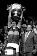 21 September 1986; Kerry captain Tommy Doyle lifts the Sam Maguire Cup, in the company of Dr Mick Loftus, President of the GAA. All-Ireland Football Final, Kerry v Tyrone, Croke Park, Dublin. Picture credit; Ray McManus / SPORTSFILE