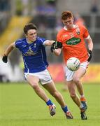 29 May 2016; Ross McQuillan of Armagh is tackled by Luke Fortune of Cavan in the Electric Ireland Ulster GAA Football Minor Championship quarter-final between Cavan and Armagh in Kingspan Breffni Park, Cavan. Photo by Oliver McVeigh/Sportsfile