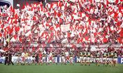 21 September 1986; The Kerry and Tyrone teams march in front of Tyrone fans in Hill 16 during the pre-match parade. Kerry v Tyrone, All-Ireland Football Final, Croke Park, Dublin. Picture credit; Ray McManus / SPORTSFILE
