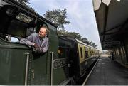 14 March 2014; A train driver looks ahead as a steam train arrives into Cheltenham Racecourse train station taking racegoers to the final day of the festival. Cheltenham Racing Festival 2014, Prestbury Park, Cheltenham, England. Picture credit: Ramsey Cardy / SPORTSFILE