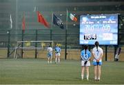 14 March 2014; Sarah Houlihan, left, Kerry and 2012 Allstars, and Aoife Lyons, Kerry and 2013 Allstars, stand together for the Chinese and Irish national anthems before the game. 2014 TG4 Ladies Football All-Star Tour, 2012 Allstars v 2013 Allstars Exhibition match, Hong Kong Football Club, Hong Kong, China. Picture credit: Brendan Moran / SPORTSFILE