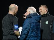 14 March 2014; Athlone Town manager Mick Cooke, centre, and Shamrock Rovers manager Trevor Crolly, right, speak with referee Tom Connolly after there was a problem with the floodlights shortly after the start of the game. Airtricity League Premier Division, Athlone Town v Shamrock Rovers, Athlone Town Stadium, Athlone, Co. Westmeath. Picture credit: Paul Mohan / SPORTSFILE