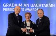 14 March 2014; Mary Wheatley, Crettyard, Laois, is presented with her GAA President's Awards for 2014 Ladies Football award by Uachtarán Chumann Lúthchleas Gael Liam Ó Néill and Denis O'Callaghan, AIB, Head of Branch Banking, left. Mary Wheatley's involvement in Ladies Football stretches across every level of the Association starting as it did with her club Crettyard before advancing to occupy the highest position as overall Association President between 1988 and 1991. Mary has also been heavily involved at Provincial level occupying a number of key roles. She is a current member of the Management Committee of the Ladies Gaelic Football Association. Picture credit: Pat Murphy / SPORTSFILE