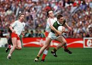 21 September 1986; Tom Spillane, Kerry, in action against Paudge Quinn and Damien O'Hagan, left, Tyrone. Kerry v Tyrone, All-Ireland Football Final, Croke Park, Dublin. Picture credit; Ray McManus / SPORTSFILE