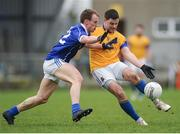 16 March 2014: Shane Mulligan, Longford, in action against Martin Reilly, Cavan. Allianz Football League Division 3, Round 5, Longford v Cavan, Pearse Park, Longford. Picture credit: Ray Lohan / SPORTSFILE