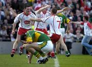25 September 2005;Tyrone players Chris Lawn, centre, Philip Jordan, 7,and Conor Gormley celebrate victory over Kerry . Bank of Ireland All-Ireland Senior Football Championship Final, Kerry v Tyrone, Croke Park, Dublin. Picture credit; Ray McManus / SPORTSFILE *** Local Caption *** Any photograph taken by SPORTSFILE during, or in connection with, the 2005 Bank of Ireland All-Ireland Senior Football Final which displays GAA logos or contains an image or part of an image of any GAA intellectual property, or, which contains images of a GAA player/players in their playing uniforms, may only be used for editorial and non-advertising purposes.  Use of photographs for advertising, as posters or for purchase separately is strictly prohibited unless prior written approval has been obtained from the Gaelic Athletic Association.