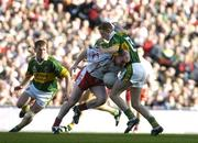25 September 2005; Chris Lawn, Tyrone, is tackled by Colm Cooper, Kerry. Bank of Ireland All-Ireland Senior Football Championship Final, Kerry v Tyrone, Croke Park, Dublin. Picture credit; Brendan Moran / SPORTSFILE *** Local Caption *** Any photograph taken by SPORTSFILE during, or in connection with, the 2005 Bank of Ireland All-Ireland Senior Football Final which displays GAA logos or contains an image or part of an image of any GAA intellectual property, or, which contains images of a GAA player/players in their playing uniforms, may only be used for editorial and non-advertising purposes.  Use of photographs for advertising, as posters or for purchase separately is strictly prohibited unless prior written approval has been obtained from the Gaelic Athletic Association.