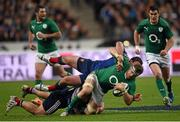 15 March 2014; Jamie Heaslip, Ireland, is tackled by Louis Picamoles and Rabah Slimani, France. RBS Six Nations Rugby Championship 2014, France v Ireland, Stade De France, Saint Denis, Paris, France. Picture credit: Stephen McCarthy / SPORTSFILE