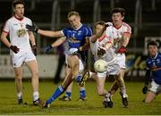 19 March 2014; Padraig Faulkner, Cavan, has his shot blocked down by Michael McCann, Tyrone. Cadbury Ulster GAA Football U21 Championship, Quarter-Final, Cavan v Tyrone, Kingspan Breffni Park, Cavan. Picture credit: Oliver McVeigh / SPORTSFILE