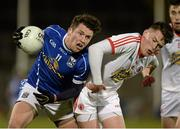 19 March 2014; Enda Flanagan, Cavan, in action against Jonathan Munroe, Tyrone. Cadbury Ulster GAA Football U21 Championship, Quarter-Final, Cavan v Tyrone, Kingspan Breffni Park, Cavan. Picture credit: Oliver McVeigh / SPORTSFILE
