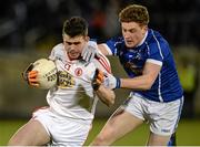 19 March 2014; Darren McCurry, Tyrone, in action against Ciaran Brady, Cavan. Cadbury Ulster GAA Football U21 Championship, Quarter-Final, Cavan v Tyrone, Kingspan Breffni Park, Cavan. Picture credit: Oliver McVeigh / SPORTSFILE