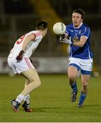 19 March 2014; Gerry Smith, Cavan, in action against Conall McCann, Tyrone. Cadbury Ulster GAA Football U21 Championship, Quarter-Final, Cavan v Tyrone, Kingspan Breffni Park, Cavan. Picture credit: Oliver McVeigh / SPORTSFILE