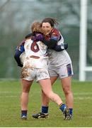 21 March 2014; Kate Keaney and Charlotte Cooney, University of Limerick, celebrate at the final whistle. O'Connor Cup, Semi-Final, University of Limerick v University College Cork. Queen's University, Belfast, Co. Antrim. Picture credit: Oliver McVeigh / SPORTSFILE