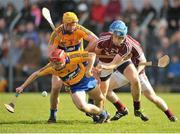 23 March 2014; Jack Browne, Clare, in action against Conor Cooney, Galway. Allianz Hurling League Division 1A Round 5, Clare v Galway, Cusack Park, Ennis, Co. Clare. Picture credit: Ray Ryan / SPORTSFILE