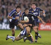 22 October 2005; Felipe Contepomi, Leinster, supported by team-mates Shane Horgan, left, and Reggie Corrigan, right, is tackled by Chris Malone, Bath. Heineken Cup 2005-2006, Pool 5, Round 1, Leinster v Bath. RDS, Ballsbridge, Dublin. Picture credit: Brendan Moran / SPORTSFILE