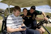 25 October 2005; Tomas O Se, Brian Dooher and Dr Con Murphy check the card during a round of golf at the Portsea Golf Club, Sorrento, Mornington Peninsula, Melbourne, Victoria, Australia. Picture credit; Ray McManus / SPORTSFILE