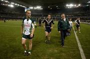 28 October 2005; Benny Coulter, Brian Dooher and Dr Con Murphy leave the field. 2005 Fosters International Rules Series, game 2, Australia v Ireland, Telstra Dome, Melbourne, Australia. Picture credit; Ray McManus / SPORTSFILE