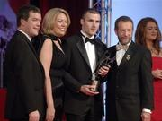 25 November 2005; Jerry O'Connor, of Cork, is presented with the Hurler of the Year by Teresa Elder, Chief Executive, Vodafone Ireland, Noel Dempsey, TD, Minister for Communications, Marine and Natural Resources and Sean Kelly, President of the GAA, at the 2005 Vodafone GAA All-Star Awards. Citywest Hotel, Dublin. Picture credit: Ray McManus / SPORTSFILE