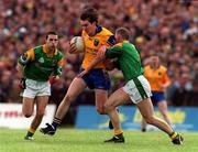 30 May 1999; Conor Connelly of Roscommon in action against Padraig Flynn of Leitrim during the Bank of Ireland Connacht Senior Football Championship at Páirc Sheáin Mhic Dhiarmada in Carrick on Shannon, Leitrim. Photo by Brendan Moran/Sportsfile