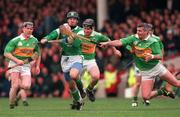 11 April 1999. Limerick's Damien Quigley in action against Kerry's Seamus McIntyre. National Hurling League, Gaelic Grounds, Limerick. Picture credit; Aoife Rice/SPORTSFILE
