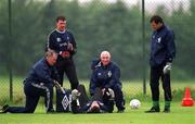 2 June 1999; An injured Shay Given is attended to by phsio Mick Byrne as goalkeeping coaches Séamus McDonagh, left, Packie Bonner, right, and team-mate Alan Kelly look on, during a Republic of Ireland training session at the AUL Complex in Clonshaugh, Dublin. Photo by Ray McManus/Sportsfile