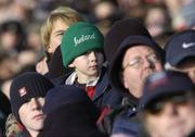 26 November 2005; A young Ireland fan keeps an eye on the action. permanent tsb International Friendly 2005-2006, Ireland v Romania, Lansdowne Road, Dublin. Picture credit: Brian Lawless / SPORTSFILE