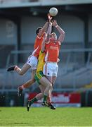 6 April 2014; Stephen Harold, left, and Kieran Toner, Armagh, contest a kickout with David Walsh, Donegal. Allianz Football League, Division 2, Round 7, Armagh v Donegal, Athletic Grounds, Armagh. Picture credit: Brendan Moran / SPORTSFILE