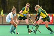 6 April 2014; Gillian Pinder, UCD, in action against Alex Speers, left, and Kate Dillon, Railway Union. Irish Senior Women's Hockey League Final, UCD v Railway Union, Banbridge Hockey Club, Banbridge, Co. Antrim.  Picture credit: Ramsey Cardy / SPORTSFILE
