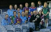 """12 December 2005; An Taoiseach Bertie Ahern TD, was in Croke Park for a """"triple header"""" with the CCIA, the Camogie Associations 3rd Level council. The day included the draws for the Ashbourne and Purcell Cup competitions, the launch of the associations """"Women in Sport"""" project and the presentation of the first national camogie Bursary awards. Pictured with An Taoiseach Bertie Ahern, TD, are second level students involved in the Women in Sport project and the 10 3rd level bursery award winners, back from left, Oonagh O'Shaughnessy, Gillian Kearney, Amy Brennan, Katie Tyan, Anna Geary, UL, Trish O'Halloran, WIT, Sharon McMahon, Mary Immaculate College, Ennis, and Aoife Murray, LIT. Front, from left, Sarah Murreann, Laura Lavery, Queens, Jennifer O'Leary, UL, Grace McNamara, IT Tralee, Niamh Taylor, TCD, Lizzy Flynn, WIT and Denise Twomey, NUIG. Croke Park, Dublin. Picture credit: Brendan Moran / SPORTSFILE"""