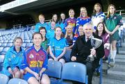 """12 December 2005; An Taoiseach Bertie Ahern TD, was in Croke Park for a """"triple header"""" with the CCIA, the Camogie Associations 3rd Level council. The day included the draws for the Ashbourne and Purcell Cup competitions, the launch of the associations """"Women in Sport"""" project and the presentation of the first national camogie Bursary awards. Pictured with An Taoiseach Bertie Ahern, TD, are second level students involved in the Women in Sport project and the 10 3rd level bursery award winners, back from left, Oonagh O'Shaughnessy, Gillian Kearney, Amy Brennan, Katie Tyan, Anna Geary, UL, Trish O'Halloran, WIT, Sharon McMahon, Mary Immaculate College, Ennis, and Aoife Murray, LIT. Front, from left, Sarah Murreann, Jennifer O'Leary, UL, Laura Lavery, Queens, Grace McNamara, IT Tralee, Niamh Taylor, TCD, Lizzy Flynn, WIT and Denise Twomey, NUIG. Croke Park, Dublin. Picture credit: Brendan Moran / SPORTSFILE"""