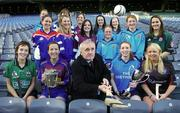 """12 December 2005; An Taoiseach Bertie Ahern TD, was in Croke Park for a """"triple header"""" with the CCIA, the Camogie Associations 3rd Level council. The day included the draws for the Ashbourne and Purcell Cup competitions, the launch of the associations """"Women in Sport"""" project and the presentation of the first national camogie Bursary awards. Pictured with An Taoiseach Bertie Ahern, TD, are second level students involved in the Women in Sport project and the 10 3rd level camogie bursery award winners. Included are Oonagh O'Shaughnessy, Gillian Kearney, Amy Brennan, Katie Tyan, Anna Geary, UL, Trish O'Halloran, WIT, Sharon McMahon, Mary Immaculate College, Ennis, and Aoife Murray, LIT, Sarah Murreann, Jennifer O'Leary, UL, Laura Lavery, Queens, Grace McNamara, IT Tralee, Niamh Taylor, TCD, Lizzy Flynn, WIT and Denise Twomey, NUIG. Croke Park, Dublin. Picture credit: Brendan Moran / SPORTSFILE"""
