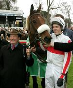 27 December 2005; Jockey Andrew McNamara with his mount Hi Cloy celebrate with trainer Michael Hourigan after winning the Paddy Power Dial-a-Bet Steeplechase. Leopardstown Racecourse, Co. Dublin. Picture credit: David Maher / SPORTSFILE