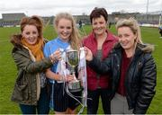 12 April 2014; St Ciaran's captain Eimear McAnespie with her sisters and current Monaghan players, Aoife, left, and Ciara, and her mother and former Monaghan player Brenda McAnespie. Tesco HomeGrown Post Primary School Junior A, St Ciaran's, Ballygawley, Co. Tyrone v Colaiste Dun lascaigh, Cahir, Co. Tipperary. Cusack Park, Mullingar, Co. Westmeath. Picture credit: Paul Mohan / SPORTSFILE