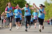 18 April 2014; Sinead Monaghan, Nicola Kiely and Samantha Villena, from Dublin, approach the finishing line during The Ray D'Arcy Show Half Million Half Marathon for LauraLynn Children's Hospice, Phoenix Park, Dublin. Picture credit: Tomás Greally / SPORTSFILE