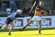 29 January 2006; Eoin Quigley, Wexford, in action against David Sweeney, Dublin. Walsh Cup, Dublin v Wexford, Parnell Park, Dublin. Picture credit: Brian Lawless / SPORTSFILE