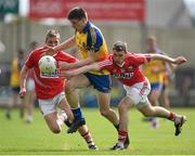 19 April 2014; Mark Healy, Roscommon, in action against Sean White, left, and Kieran Histon, Cork. Cadbury GAA Football U21 Championship Semi-Final, Cork v Roscommon, O'Moore Park, Portlaoise, Co. Laois.  Picture credit: Brendan Moran / SPORTSFILE