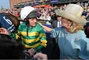 21 April 2014; Jockey Barry Geraghty celebrates with Noreen McManus, wife of owner JP McManus, after winning the Boylesports Irish Grand National Steeplechase with Shutthefrontdoor. Fairyhouse Easter Festival, Fairyhouse, Co. Meath. Picture credit: Brendan Moran / SPORTSFILE