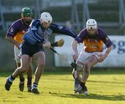 29 January 2006; Ciaran Kenny, Wexford, in action against Tom Brady, Dublin. Walsh Cup, Dublin v Wexford, Parnell Park, Dublin. Picture credit: Brian Lawless / SPORTSFILE