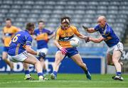26 April 2014; Martin O'Leary, Clare, in action against Peter Acheson, left, and Andrew Morris, Tipperary. Allianz Football League Division 4 Final, Tipperary v Clare, Croke Park, Dublin. Picture credit: Barry Cregg / SPORTSFILE