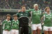 4 February 2006; Ireland team mascots Fred Kelly, left, and Dean Hutchinson stand alongside team captain Brian O'Driscoll and players John Hayes and Jerry Flannery as they sing the national anthems before the game. RBS 6 Nations 2006, Ireland v Italy, Lansdowne Road, Dublin. Picture credit; Brendan Moran / SPORTSFILE
