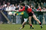 5 February 2006; Ger Robinson, Meath, in action against Damien Rafferty, Down. Allianz National Football League, Division 1B, Round 1, Down v Meath, St. Patrick's Park, Newcastle, Co. Down. Picture credit: Brendan Moran / SPORTSFILE