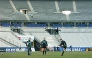 10 February 2006; Ireland out-half Ronan O'Gara practices his kicking watched by team-mate David Humphreys and kicking coach Mark Tainton. Ireland Kicking Practice, Stade de France, Paris, France. Picture credit; Brendan Moran / SPORTSFILE