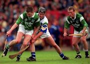 30 May 1999; Mark Foley, Limerick, in action against Anthony Kirwan, Waterford, as Dave Clarke, Limerick (Right) looks on. Waterford v Limerick, Munster Hurling Championship, Páirc U' Chaoimh, Cork. Picture credit; Ray McManus/SPORTSFILE