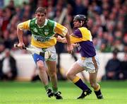 20 June 1999; Michael Duignan of Offaly in action against Sean Flood of Wexford during the Guinness Leinster Senior Hurling Championship semi-final match between Offaly and Wexford at Croke Park in Dublin. Photo by Ray McManus/Sportsfile