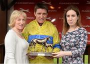 1 May 2014; Ann Murray, wife of Colm Murray, and his daughter Kate present winning jockey Barry Geraghty with his trophy after the Colm Murray Memorial Handicap Hurdle. Punchestown Racecourse, Punchestown, Co. Kildare. Picture credit: Matt Browne / SPORTSFILE