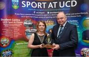 1 May 2014; Orla Haran of the Women's Soccer Club is presented with the Varsity Team of the Year award by Professor Andrew Deeks, President of UCD, during the UCD Sports Awards 2013/2014. Astra Hall, UCD, Belfield, Dublin. Picture credit: Stephen McCarthy / SPORTSFILE