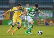 2 May 2014; Luke Byrne, Shamrock Rovers, in action against Shane Tracy, Limerick FC. Airtricity League Premier Division, Shamrock Rovers v Limerick FC, Tallaght Stadium, Tallaght, Co. Dublin. Picture credit: Ramsey Cardy / SPORTSFILE